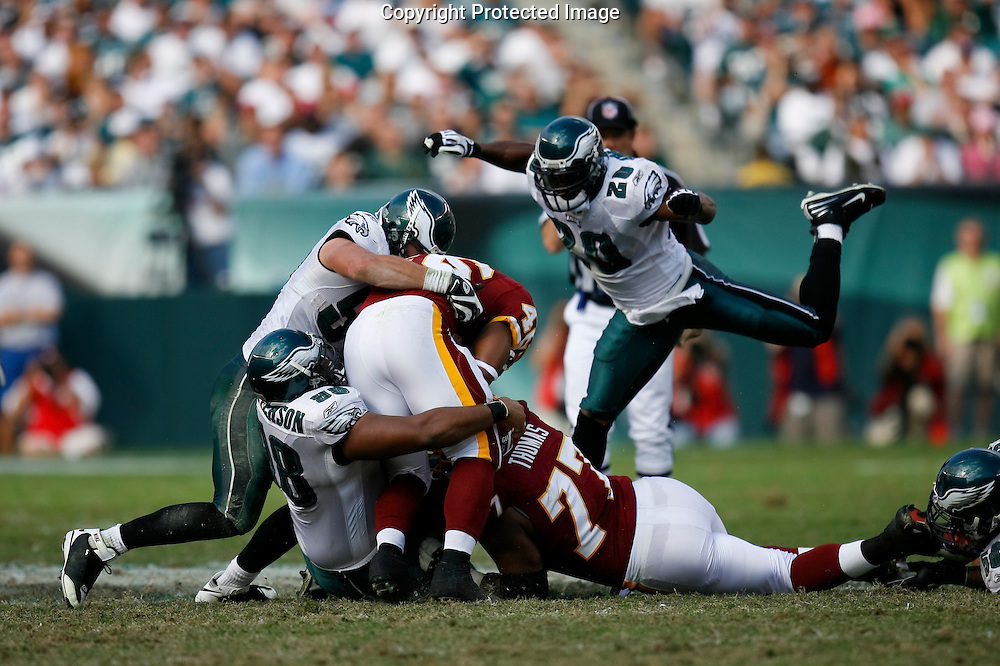5 Oct 2008: Philadelphia Eagles defensive tackle Mike Patterson #98 brings down Washington Redskins running back Ladell Betts #46 with some help from Philadelphia Eagles linebacker Stewart Bradley #55 and safety Brian Dawkins #20 during the game against the Washington Redskins on October 5th, 2008. The Redskins won 23-17 at Lincoln Financial Field in Philadelphia, Pennsylvania.