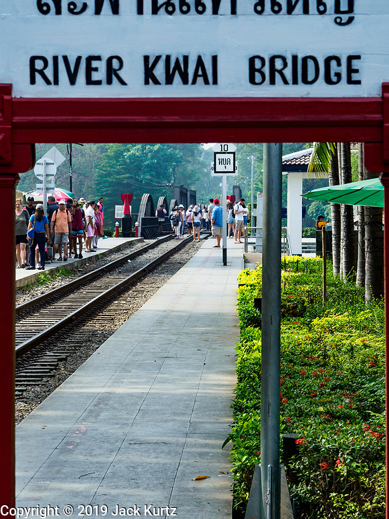 """09 JANUARY 2019 - KANCHANABURI, THAILAND: The train station at the """"Bridge On the River Kwai"""" in Kanchanaburi. Hundreds of thousands of Asian slave laborers and Allied prisoners of war died in World War II constructing the """"Death Railway"""" between Bangkok and Rangoon (now Yangon), Burma (now Myanmar) for the Japanese during World War II.  The bridge is now one of the most famous tourist attractions in Thailand.     PHOTO BY JACK KURTZ"""