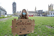 A girl is seen protesting against coronavirus lockdown measure,  against the vaccine, against 5G and pro-freedom protest near Parliament Square in London, Saturday, May 2, 2020. Civil liberties have been limited with self-isolation and social distancing imposed by the government to limit the spread of the highly contagious COVID-19 coronavirus. (Photo/Vudi Xhymshiti)