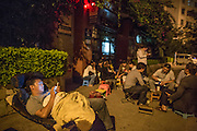 KUNMING, CHINA - JULY 31: (CHINA OUT) <br /> <br /> Parents Queue Up All Night For Their Kid's Primary School Enrolment<br /> <br /> Parents queue up all night for their kids primary school enrolment on July 31, 2014 in Kunming, Yunnan province of China. Although the persuation of not queuing up over night is given by the Chunyuan primary school, a lot of parents wait in line over night to apply for Chunyuan primary school on July 31. A Chunyuan primary school personnel expressed that every children of school age in this area could enter the school, so there is no need for parents to wait in line over night for the signing in of the school. <br /> ©Exclusivepix