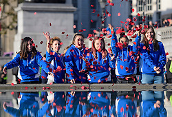 © Licensed to London News Pictures. 11/11/2016. London, UK. Students from South London East College release poppies in to the fountains during Silence in the Square, a service held in Trafalgar Square, London to mark Remembrance Day. A minutes silence is held on the 11th hour of the 11th day of the 11th month, to recall the end of hostilities of World War I.  Photo credit: Ben Cawthra/LNP