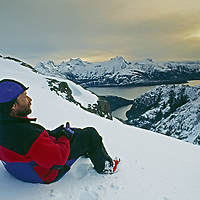 Cordillera Sarmiento, Patagonia, Chile. A mountaineer relaxes at camp in this previously unexplored range.