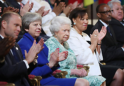 Queen Elizabeth II is joined by Prime Minister Theresa May, Prime Minister of Malta Joseph Muscat and Baroness Patricia Scotland during the formal opening of the Commonwealth Heads of Government Meeting in the ballroom at Buckingham Palace in London.