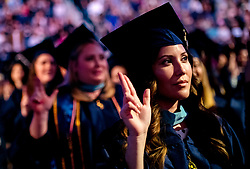 April 29, 2019 - Riverside, California, U.S. - Graduate Vivian Varga shows a Ã'Lance Up'' hand gesture for the school song during Cal Baptist University commencement ceremony for the College of Engineering, College of Health Science and School of Education in Riverside on Monday morning, April 29, 2019. (Credit Image: © Watchara Phomicinda/SCNG via ZUMA Wire)
