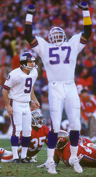 New York Giants kicker Matt Bahr (9) follows the flight of his game-winning field goal against the San Francisco 49ers as time expires in the fourth quarter of their NFC championship football game, Sunday, Jan. 20, 1991 at Candlestick Park in San Francisco. Giants' Larry McGrew (57) exults while 49ers' Dexter Carter (35) looks less pleased. The Giants won, 15-13 and now move on to the Super Bowl against the Buffalo Bills. (Photo by D. Ross Cameron)