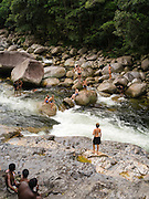 People enjoy playing in the Mossman River at Mossman Gorge, Daintree National Park, near Mossman, Queensland, Australia.