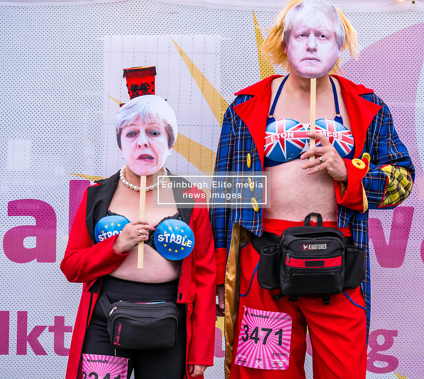 Pictured: Moonwalk Scotland, Edinburgh, Scotland, United Kingdom, 08 June 2019. The 14th Moonwalk Scotland 'Walk the Walk' night-time event with several thousand participants wearing specially decorated bras choose with a circus theme to raise money  and awareness for breast cancer causes. Irene & Graham Mcintosh, Moonwalk regulars. Irene is walking her 9th full marathon & Graham is walking his 7th full marathon.<br /> <br /> Sally Anderson | EdinburghElitemedia.co.uk