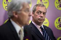 © Licensed to London News Pictures . 03/11/2015 . Oldham , UK . Candidate JOHN BICKLEY and party leader NIGEL FARAGE during a Q&A at the launch of the UKIP campaign for the seat of Oldham West and Royton , at the Railway Hotel in Royton . The by-election has been triggered by the death of MP Michael Meacher . Photo credit : Joel Goodman/LNP