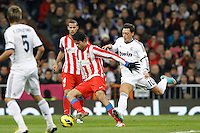 01.12.2012 SPAIN -  La Liga 12/13 Matchday 14th  match played between Real Madrid CF vs  Atletico de Madrid (2-0) at Santiago Bernabeu stadium. The picture show Diego da Silva Costa (Brazilian midfielder of At. Madrid) and  Mesut Ozil (German midfielder of Real Madrid)