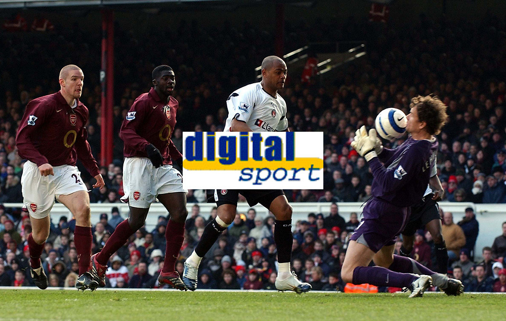 Photo: Olly Greenwood.<br />Arsenal v Charlton Athletic. The Barclays Premiership. 18/03/2006. <br />Charlton's Shaun Bartlett gets in front of the Arsenal defence but Jens Lehmann saves his shot.