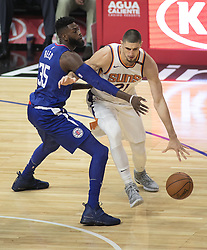 October 21, 2017 - Los Angeles, California, U.S - Alex Len #21 of the Phoenix Suns gets by Willie Reed #35 of the Los Angeles Clippers during their regular season game on Saturday October 21, 2017 at the Staples Center in Los Angeles, California. Clippers defeat Suns, 130-88. (Credit Image: © Prensa Internacional via ZUMA Wire)
