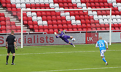 Christy Pym of Peterborough United dives in vein as Grant Leadbitter of Sunderland (not in picture) scores the only goal of the game - Mandatory by-line: Joe Dent/JMP - 26/09/2020 - FOOTBALL - Stadium of Light - Sunderland, England - Sunderland v Peterborough United - Sky Bet League One