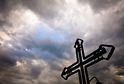 02.05.2011, Kaprun, AUT, FEATURE RELIGION, im Bild ein Kreuz auf dem Kirchbichl Kaprun, am Himmel ziehen Regenwolken auf, düstere Stimmung // a cross on the Kirchbichl Kaprun, the sky to attract rain clouds, gloom, EXPA Pictures © 2011, PhotoCredit: EXPA/ J. Feichter