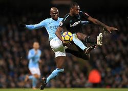 Manchester City's Eliaquim Mangala (left) and West Ham United's Michail Antonio battle for the ball