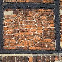 Unusual brick pattern in historic tudor building in Faversham, Kent, England