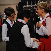 Petra Ritler, from left, and her dance partner Kirsten Hierholz, of Frankfurt, Germany, help fellow dancer Tanya Lehd, also of Frankfurt, dress for the women's adult standard division of the same-sex ballroom dancing competition during the 2007 Eurogames at the Waagnatie hangar in Antwerp, Belgium on July 14, 2007. ..Over 3,000 LGBT athletes competed in 11 sports, including same-sex dance, during the 11th annual European gay sporting event. Same-sex ballroom is a growing sports that has been happening in Europe for over two decades.