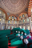 The Tomb & sacrophaguses of Ottoman  Sultan Murad III and his family in the outer courtyard of Aya Sophia. Built in in 1599 by Architect Davud Agha and his assistant Dalgıç Ahmet Agha, it is one of the largest Ottoman tombs with its hexagon layout and İznik ceramic tiles, double domes, Istanbul, Turkey .<br /> <br /> If you prefer to buy from our ALAMY PHOTO LIBRARY  Collection visit : https://www.alamy.com/portfolio/paul-williams-funkystock/hagia-sophia-istanbul.html<br /> <br /> Visit our TURKEY PHOTO COLLECTIONS for more photos to download or buy as wall art prints https://funkystock.photoshelter.com/gallery-collection/3f-Pictures-of-Turkey-Turkey-Photos-Images-Fotos/C0000U.hJWkZxAbg