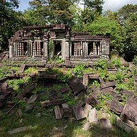 The old library, one of many ruins of the Beng Mealea temple site. Beng Mealea is accessible since it has been cleared from landmines in 2003. As the site was more or less left in the same condition as it was found, exploring the area might be more enjoyable as the better known touristic temples.