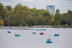 © Licensed to London News Pictures. 07/09/2020. London, UK. After the wind and rain, members of the public in pedalos enjoy some warm weather while on the Serpentine in Hyde Park as a mini heatwave is expected to hit the South East this week with temperatures predicted to reach up to 24c. Photo credit: Alex Lentati/LNP