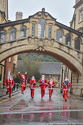 © Licensed to London News Pictures. 12/12/2015. OXFORD. Santa Run 2015 took place in Oxford. 2500 runners tackled the 3km course through the historic streets of the University city.. Photo credit : MARK HEMSWORTH/LNP