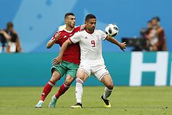 (l-r) Younes Belhanda of Morocco, Omid Ebrahimi of IR Iran