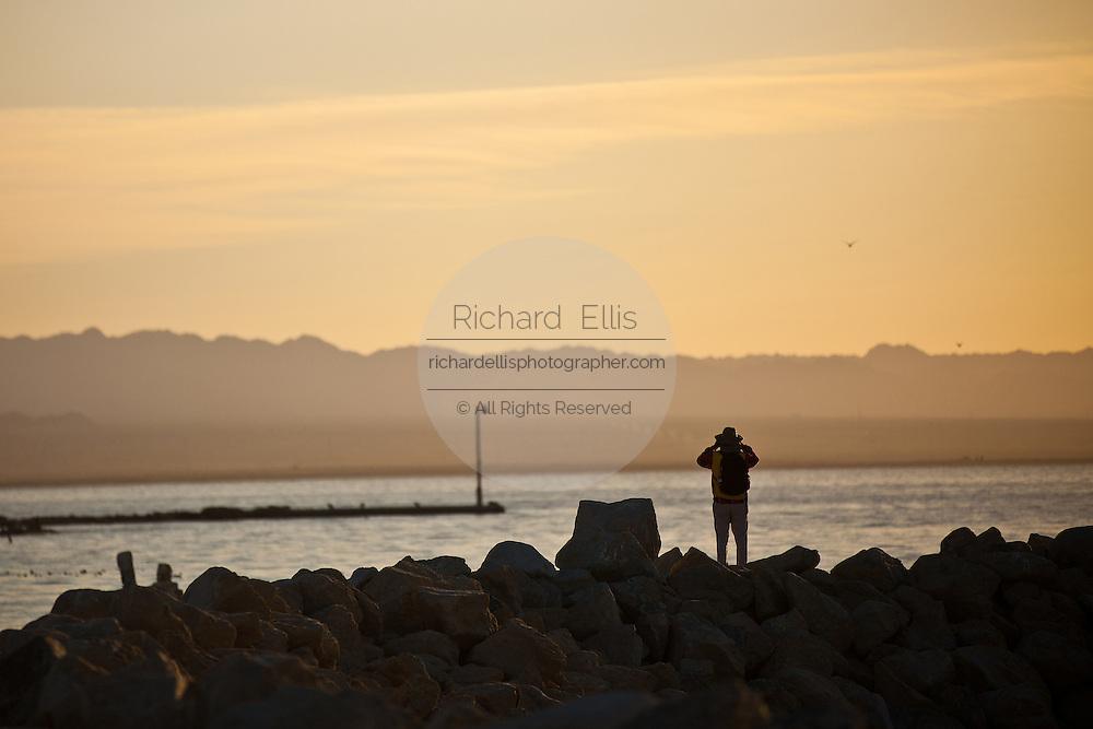 Birdwatcher along the coast of the Salton Sea Imperial Valley, CA.