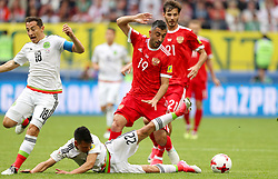 Mexico's Hirving Lozano and Russia's Alexander Samedov battle for the ball
