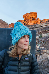 Sarah Hepola hiking out after day of climbing, Hueco Tanks State Park & Historic Site, El Paso, Texas. USA.