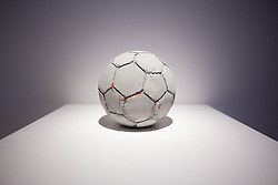 © Licensed to London News Pictures. 20/06/2013. London, UK. 'Football' (2012) a sculpture made using reconstituted concrete from the West Bank-Israel 'apartheid wall' by Palestinian artist Khaled Jarrar is seen at the press view for a new exhibition at the Ayyam Gallery in London today (20/06/2013). The exhibition, entitled 'Whole in the Wall', uses cement taken by Khaled from the 700km long apartheid wall that separates the West Bank from the State of Israel. Photo credit: Matt Cetti-Roberts/LNP
