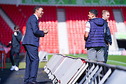 Sky Sports presenter Chris Kamara shares a joke with Wallsall forward Josh Gordon (10) during the EFL Sky Bet League 2 match between Harrogate Town and Walsall at the Keepmoat Stadium, Doncaster, England on 19 September 2020.