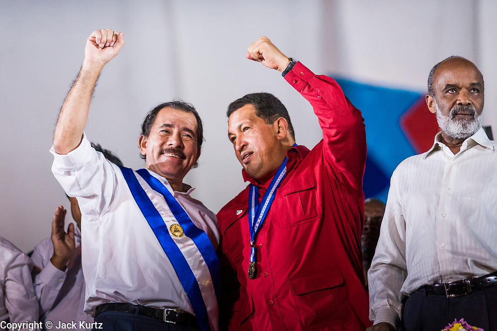 """10 JANUARY 2007 - MANAGUA, NICARAGUA: DANIEL ORTEGA, President of Nicaragua, left, and HUGO CHAVEZ, President of Venezuela, at Ortega's inauguration in Managua. Daniel Ortega, the leader of the Sandanista Front, was sworn in as the President of Nicaragua Wednesday. Ortega and the Sandanistas ruled Nicaragua from their victory of """"Tacho"""" Somoza in 1979 until their defeat by Violetta Chamorro in the 1990 election.  Photo by Jack Kurtz"""