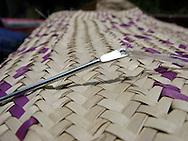 Weaving a mat in Rwanda.