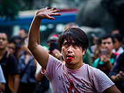 19 OCTOBER 2018 - BANGKOK, THAILAND: A man who cut his tongue goes as a mark of fealty to Devi goes into a trance during Navratri observances in Bangkok. Navratri is a nine night (10 day) long Hindu celebration that marks the end of the monsoon and honors of the divine feminine Devi (Durga). The festival is celebrated differently in different parts of India, but the common theme is the battle and victory of Good over Evil based on a regionally famous epic or legend such as the Ramayana or the Devi Mahatmya. Navratri is celebrated throughout Southeast Asia in communities that have a large Hindu population.    PHOTO BY JACK KURTZ