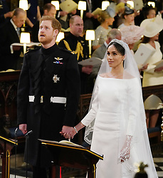 Prince Harry and Meghan Markle during their wedding service at St George's Chapel, Windsor Castle.