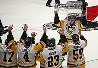 NASHVILLE, TN - JUNE 11:  Sidney Crosby #87 of the Pittsburgh Penguins celebrates with his teammates by hoisting the Stanley Cup trophy after defeating the Nashville Predators 2-0 in Game Six of the 2017 NHL Stanley Cup Final at the Bridgestone Arena on June 11, 2017 in Nashville, Tennessee.  (Photo by Frederick Breedon/Getty Images)