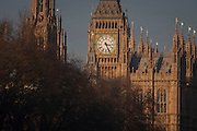 The British Houses of Parliament, seat of the UK's government, on 17th January 2017, in London England. The Elizabeth Tower (previously called the Clock Tower) named in tribute to Queen Elizabeth II in her Diamond Jubilee year – was raised as a part of Charles Barry's design for a new palace, after the old Palace of Westminster was largely destroyed by fire on the night of 16 October 1834. The new Parliament was built in a Neo-gothic style. Although Barry was the chief architect of the Palace, he turned to Augustus Pugin for the design of the clock tower. It celebrated its 150th anniversary on 31 May 2009. The tower was completed in 1858 and has become one of the most prominent symbols of both London and England.