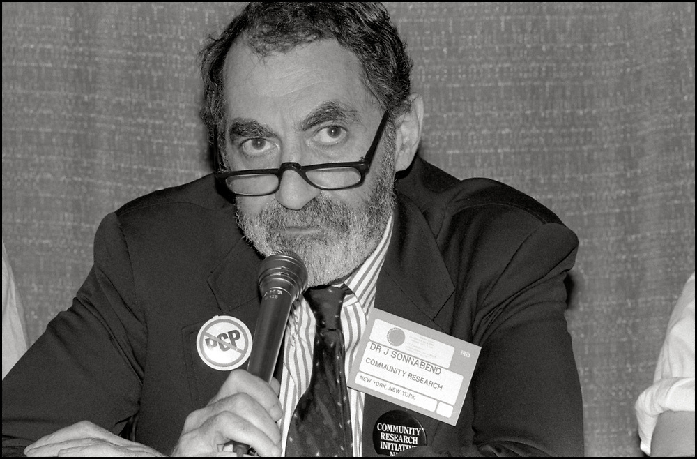 Joseph Sonnabend, an Afrikaans physician, scientist and AIDS researcher, speaking on a panel about the possible Antiviral drugs that could be used to combat HIV/AIDS at the Fifth International AIDS Conference.<br /> <br /> As one of the first physicians to notice among his gay male patients the immune deficiency that would later be named AIDS, during the 1980s and 1990s he treated many hundreds of HIV-positive people.  Sonnabend helped create several AIDS organisations, including the AIDS Medical Foundation (now amfAR), the nonprofit Community Research Initiative (now ACRIA), which pioneered community-based research, and the PWA Health Group, the first and largest formally recognized buyers' club for AIDS medications.