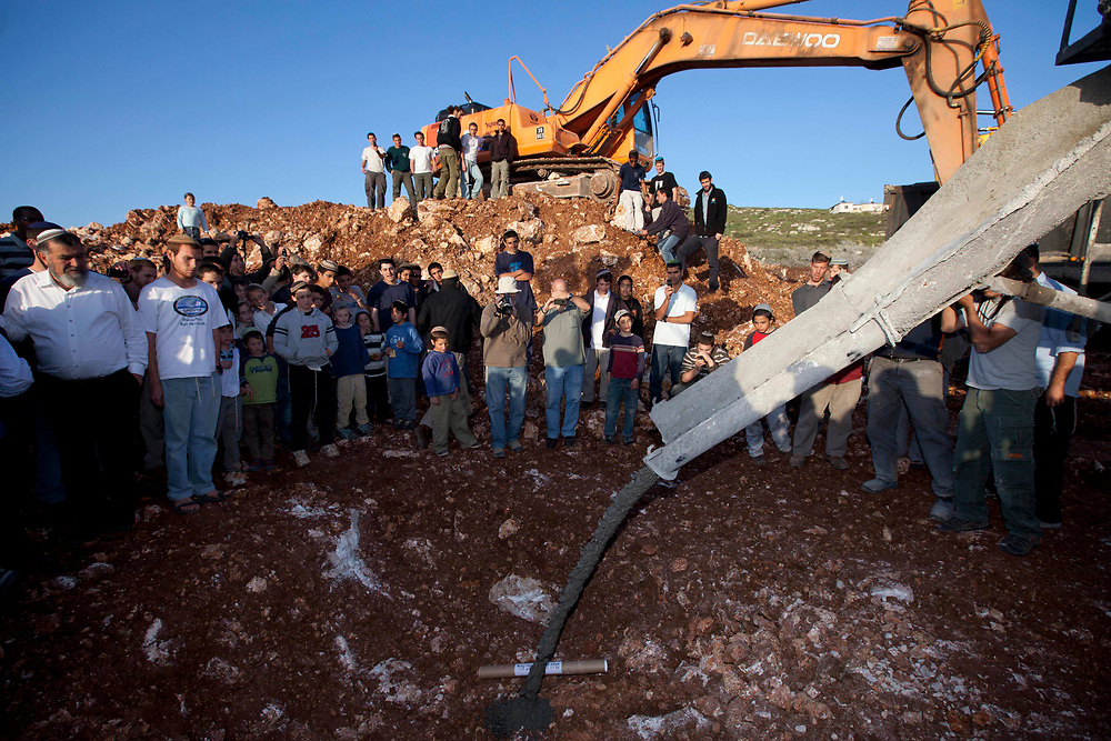 A cornerstone is laid for what will be a new Torah study hall called 'Mishkan Ehud', built in honor of the slain Ehud (Udi) Fogel in the West Bank settlement of Itamar on April 10, 2011, prior to a memorial service marking 30 days since the murder of five members of the Fogel family, including three children, who were stabbed to death in their beds as they slept in the West Bank settlement of Itamar.
