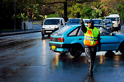 Cape Town - 180702 - Pictured is a traffic officer directing traffic on the corner of Newlands Road and Paradise Road (M3) as a result of the traffic lights not working. Picture: David Ritchie/African News Agency/ANA