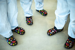 © Licensed to London News Pictures. 05/02/2021. Oldham , UK . Clinicians wearing matching doughnut crocs on the ward . Inside Royal Oldham Hospital's Covid ITU where patients, most of them unconscious , are treated for the effects of Coronavirus . Photo credit : Joel Goodman/LNP