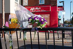 © Licensed to London News Pictures. 02/11/2018. Lewisham, UK. Flowers being placed at the scene where police have launched an investigation after a teenager was fatally stabbed at Morleys takeaway in Bellingham, Lewisham. Photo credit: Grant Falvey/LNP