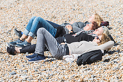 © Licensed to London News Pictures. 09/09/2017. Brighton, UK. Members of the public take advantage of the late summer sunshine to spend time on the beach in Brighton and Hove. Photo credit: Hugo Michiels/LNP