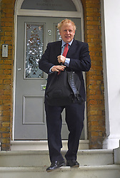 Former Foreign Secretary Boris Johnson leaves his home in London.