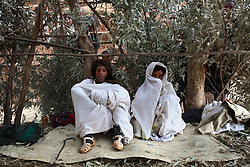 Alelegn Challe, 23, and his bride, Leyualem Mucha, 14, sit together for the first time at his home on their wedding day in Yeganda Village,   Amhara Region, Ethiopia on May 23, 2007.