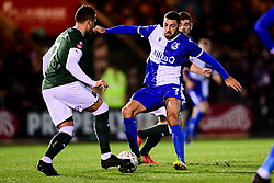 Liam Sercombe of Bristol Rovers challenges Antoni Sarcevic of Plymouth Argyle - Mandatory by-line: Ryan Hiscott/JMP - 17/12/2019 - FOOTBALL - Home Park - Plymouth, England - Plymouth Argyle v Bristol Rovers - Emirates FA Cup second round replay