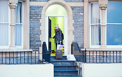 © London News Pictures. 31/01/2014. Aberystwyth, UK. A young student leaving her seafront flat in Aberystwyth. <br /> The  University authorities are planning to close their seafront halls of residence as a precautionary measure at 16.00 this afternoon in advance of forecast high winds and stormy seas. Of the 600 students living on the seafront, about 450 are in university-owned accommodation.  They are being offered alternative accommodation on the university campus, or financial help to return home for the weekend. The town of Aberystwyth suffered severe damage to it's seafront during recent storms which battered the West coast of the UK and Ireland. Photo credit: Keith Morris/LNP