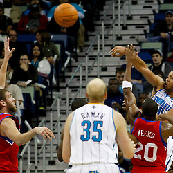 January 4, 2012; New Orleans, LA, USA; New Orleans Hornets shooting guard Eric Gordon (10) passes as Philadelphia 76ers guard Jodie Meeks (20) defends during the second half of a game at the New Orleans Arena. The 76ers defeated the Hornets 101-93.  Mandatory Credit: Derick E. Hingle-US PRESSWIRE