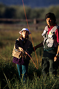 Father fly fishing with his daughter.