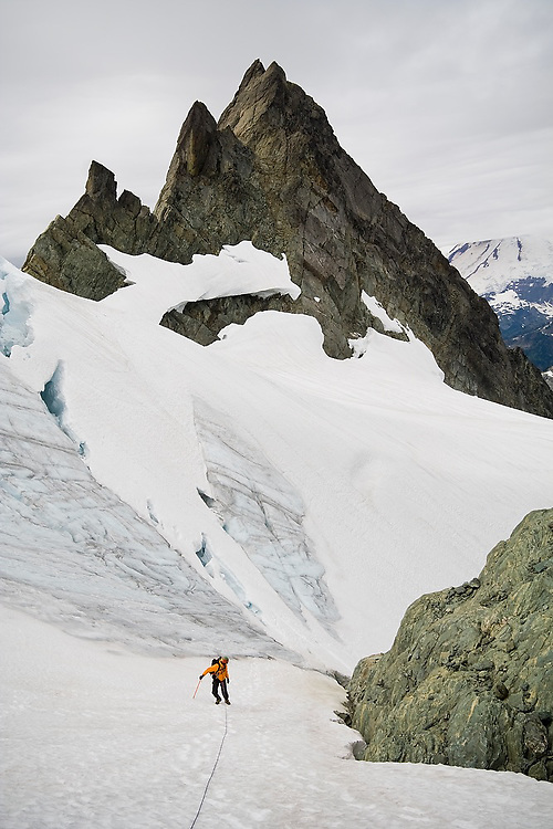 Yoav Bar-Ness climbs up to the Sulphide Glacier below the summit of Mount Shuksan from Hell's Highway, North Cascades National Park, Washington.