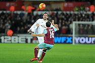 Gylfi Sigurdsson of Swansea city © looks to go past Mark Noble of West Ham Utd. Barclays Premier league match, Swansea city v West Ham Utd at the Liberty Stadium in Swansea, South Wales  on Sunday 20th December 2015.<br /> pic by  Andrew Orchard, Andrew Orchard sports photography.